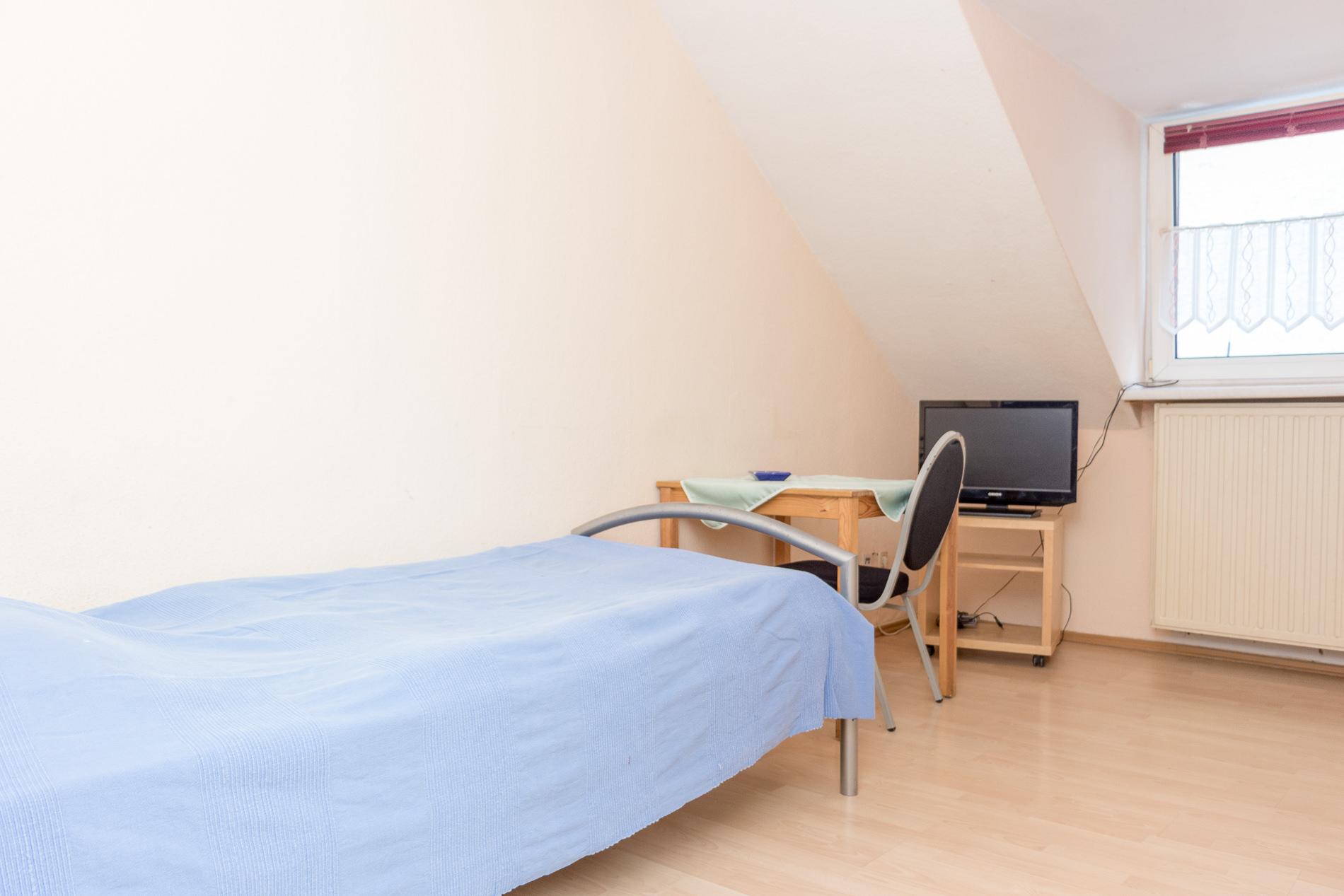 Schalfzimmer mit Kabelfernsehen Pension Dortmund